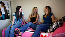 students chatting in bedroom