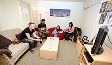 students playing video games in living room
