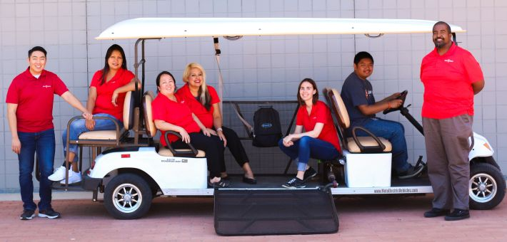 Photo of DRS Staff gathered around their wheelchair accessible cart.