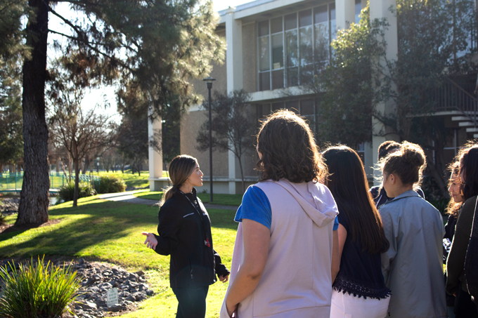 University ambassador giving a group of students a tour
