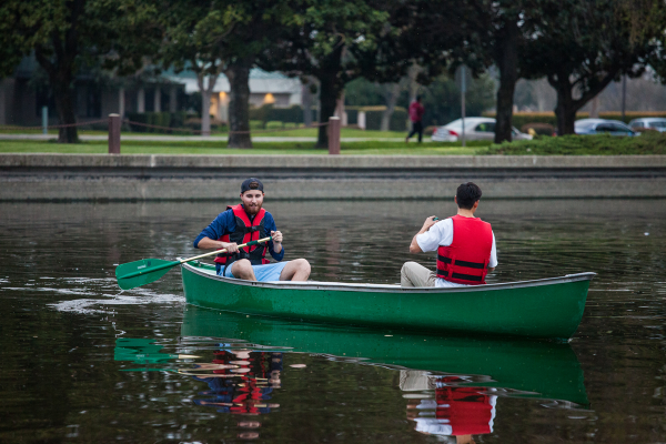 Fraternity brothers canoeing