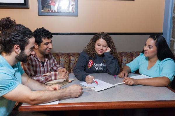 Students studying in a group of four.