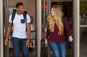 Students exit the campus library.